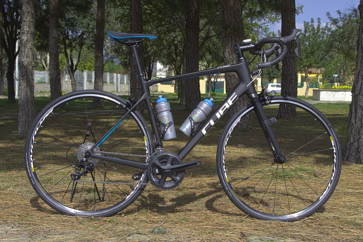 Black and blue Cube Attain Pro road bike
