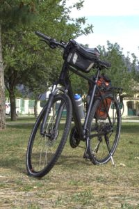 Trekking Bike Cube with pannier and Handlebar bag front view